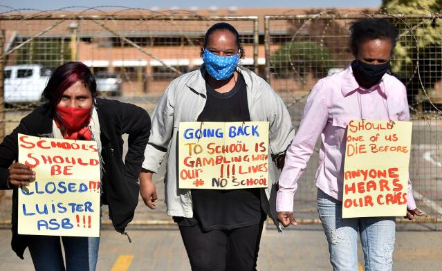 In this July 6, 2020 file photo, a handful of concerned parents picket outside a South African school, calling for it to be shut due to Covid-19. President Cyril Ramaphosa said on July 23  the government had decided to close public schools for all by essential grades from July 27 until August 24. Photo: Thobile Mathonsi/African News Agency (ANA)