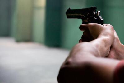 A gun revolver firing