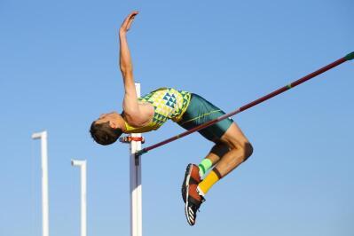 A pole vaulter clears the pole.