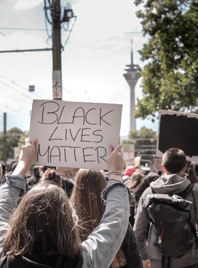 A protester holding a placard written Black Lives Matter