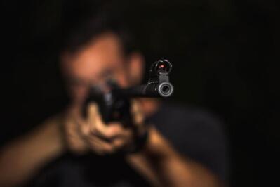 A man aims a rifle.