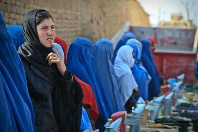 A line of women in traditional Islamic garb.