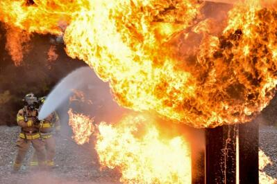 A firefighter fights an inferno.
